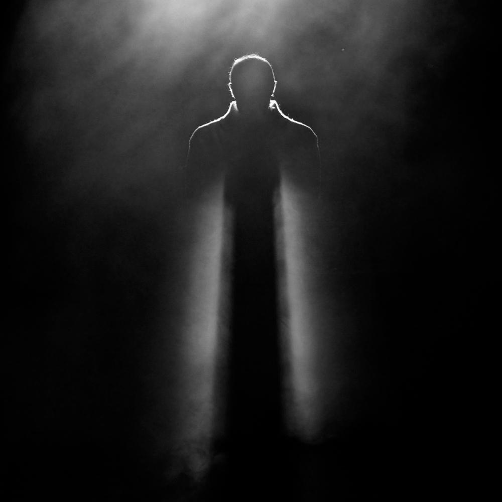 man-in-spotlight-shutterstock_125895614